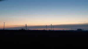 photo of windturbines at sunset